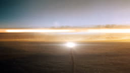 Space Rocket Launching Into Space Through the Clouds at Sunset