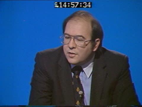 special: pab 14.45; england: london: gir: int live studio dr garry hunt discussion sot - ピーター・シソンズ点の映像素材/bロール