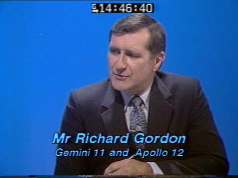 special: pab 14.45; england: london: gir: int live studio presenter peter sissons discussion with richard gordon sot - ピーター・シソンズ点の映像素材/bロール