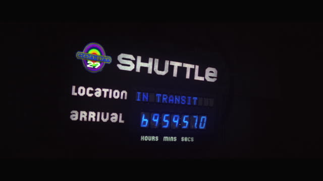 CU Space shuttle arrival departure board showing time in space station
