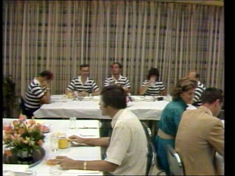 Florida Cape Canaveral EXT GV Space shuttle 'Challenger' on pad LMS Crew at preflight breakfast MS Sally Ride American astronaut helping another...