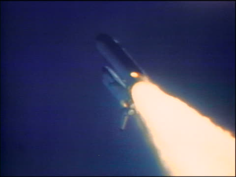 1986 space shuttle challenger moving up into sky before explosion / shows fire spot development - 1986 stock-videos und b-roll-filmmaterial