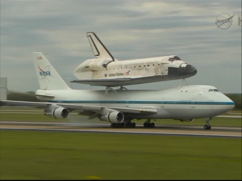 space shuttle discovery atop a modified airplane lands at washington dc dulles airport. - space shuttle discovery stock videos & royalty-free footage