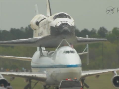 space shuttle discovery atop a modified airplanen taxis after landing at washington dc dulles airport. - space shuttle discovery stock videos & royalty-free footage