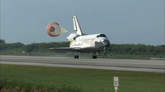 space shuttle discovery returns from sts131 mission that delivered a multipurpose logistics module to the international space station / space shuttle... - landing touching down stock videos & royalty-free footage