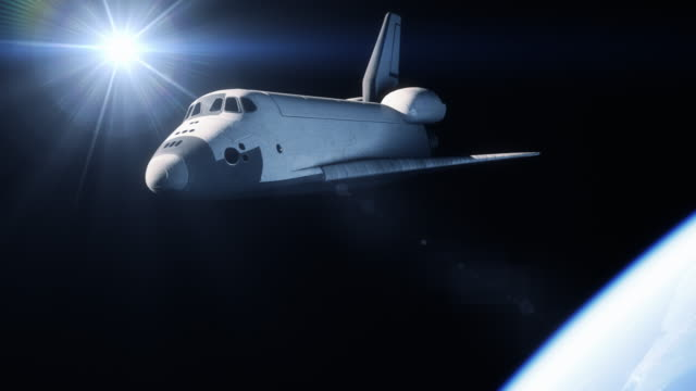 space shuttle in orbit above earth - razzo spaziale video stock e b–roll