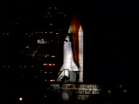 MWA Space shuttle on launch pad, engines firing up, NASA