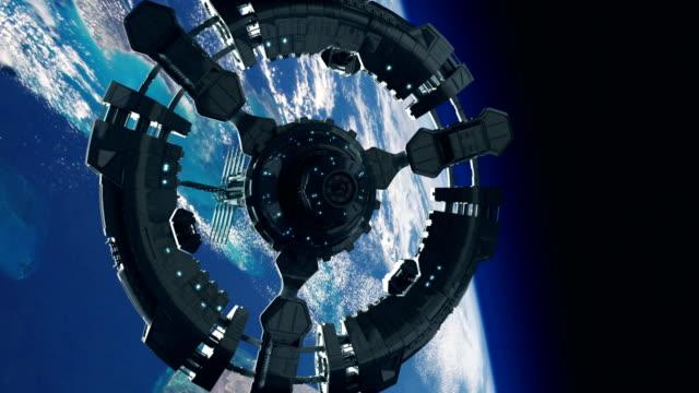 惑星地球軌道上の宇宙ステーション。宇宙探査。 - 宇宙船点の映像素材/bロール
