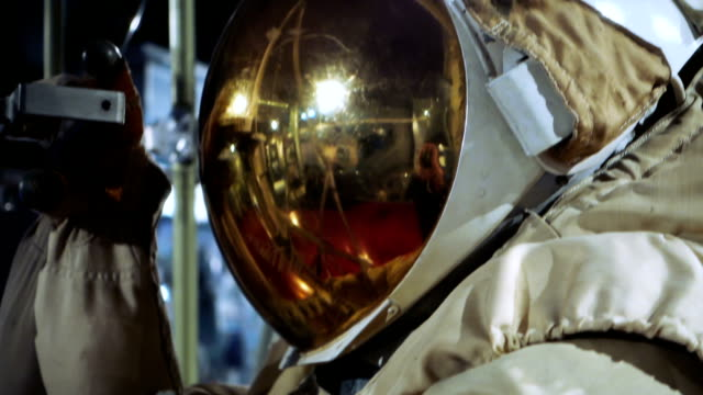 space suit with gold coated visor - astronaut stock videos & royalty-free footage