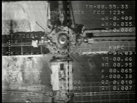 1997 spacecraft point of view docking with mir space station / seen from progress spacecraft cargo ship - mir space station stock-videos und b-roll-filmmaterial