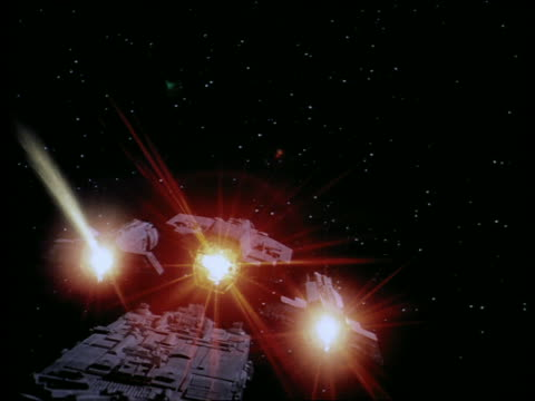 Spaceship detaching into three sections + shooting off blue lasers in fight