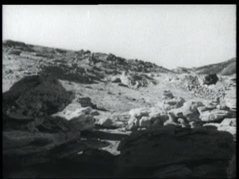 b/w 1952 spaceship landing on rocky terrain in desert - 1952 stock videos & royalty-free footage