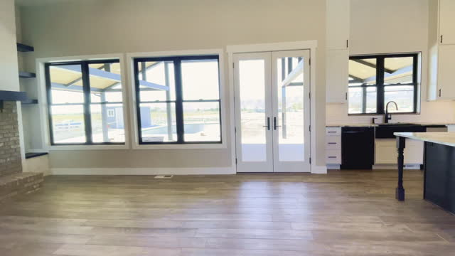 spacious kitchen, island counter toward the french doors and retro-farm sink, new single-family home - kitchen worktop stock videos & royalty-free footage