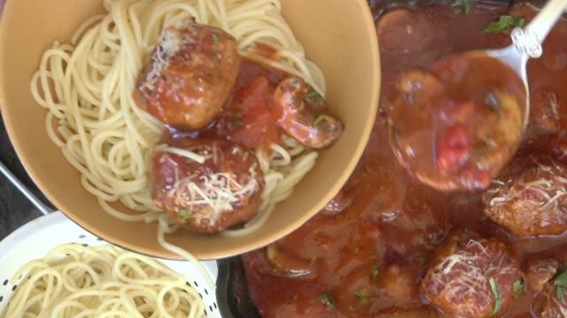 spaghetti and meatballs in marinara sauce - meatballs stock videos & royalty-free footage