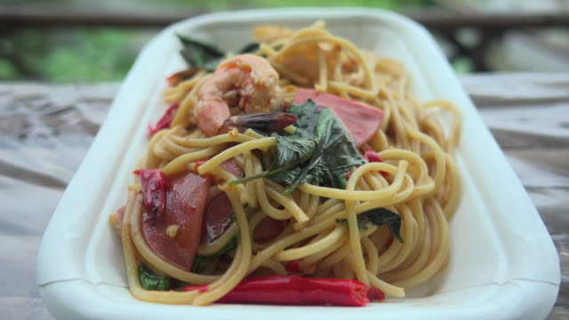 spaghetti fried with shrimps dolly shot - italian food stock videos & royalty-free footage