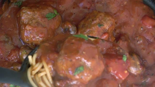 spaghetti meatballs with parmigiano reggiano in marinara sauce - parmigiano video stock e b–roll