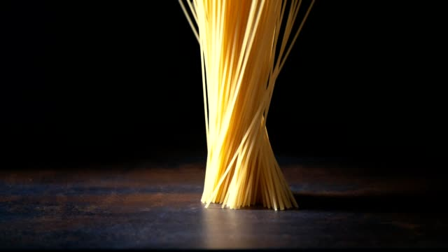 spaghetti pasta falling down - pasta video stock e b–roll