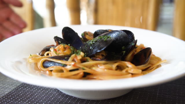 Spaghetti with mussels pasta dish close up directly above