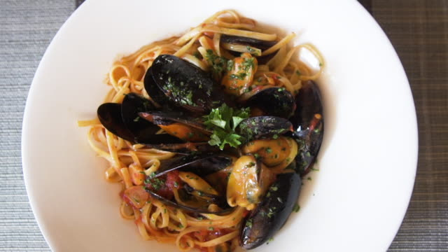 spaghetti with mussels pasta dish close up directly above - animal shell stock videos & royalty-free footage