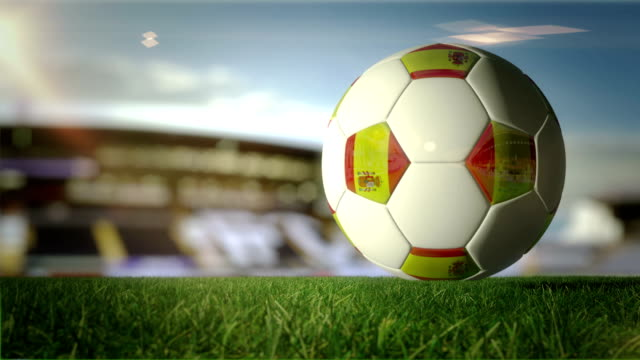 spain ball turn at stadium - loopable - spanish flag stock videos and b-roll footage