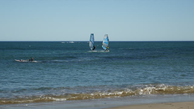 spain cambrils two windsurfers off shore - cambrils stock videos & royalty-free footage