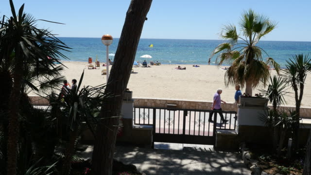 spain cambrils view of beach beyond gate - cambrils stock videos & royalty-free footage
