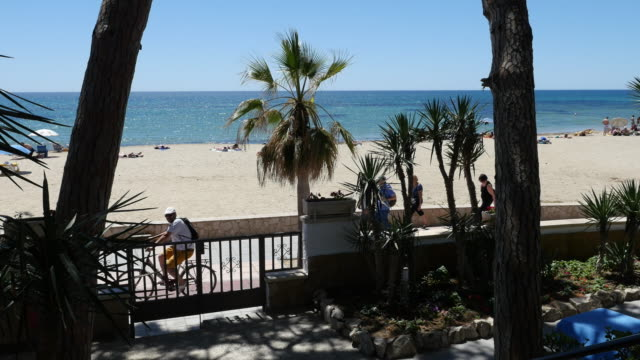 spain cambrils view past gate toward sea - cambrils stock videos & royalty-free footage