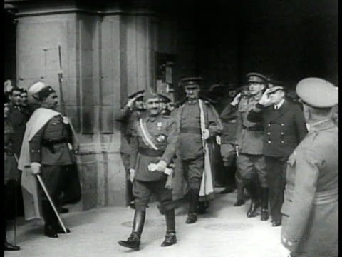 spain dictator francisco 'el caudillo' franco in generals uniform exiting building w/ aides & officials, waving to crowd, guards. spanish soldiers... - benito mussolini stock videos & royalty-free footage