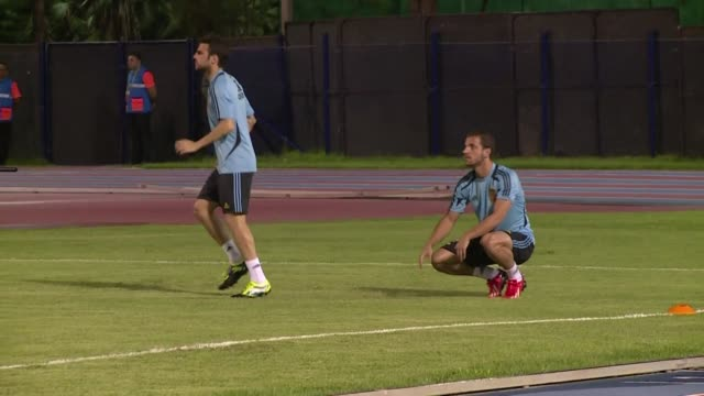 spain players cesc fabregas and roberto soldado train separately from their teammates due to muscle pains they felt after the game against nigeria... - semifinal round stock videos & royalty-free footage