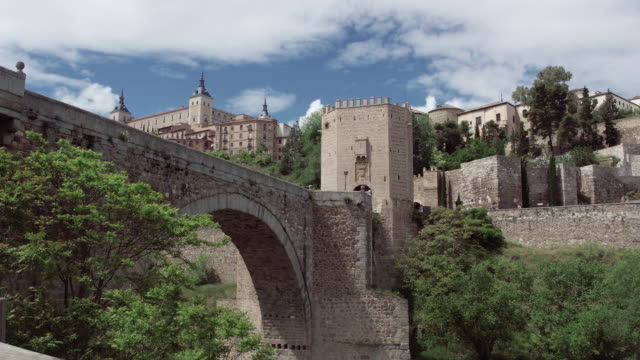 spain pov walk on ancient streets of toledo old town - fortress stock videos & royalty-free footage