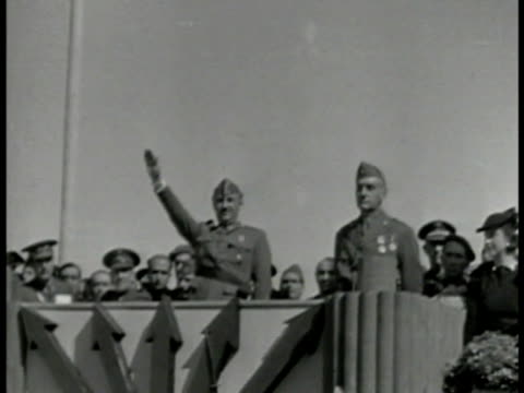 '1936 spain' superimposed over italian soldiers marching la ws general francisco franco saluting from stand ws italian troops marching cu benito... - benito mussolini stock-videos und b-roll-filmmaterial