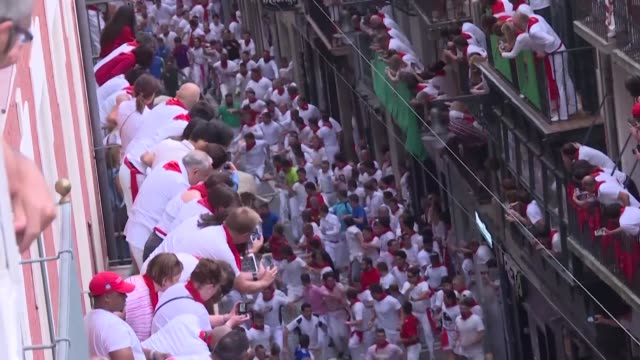 spain's famous bull run festival in pamplona begins with hundreds of men running in front of cattle - comunidad foral de navarra stock videos and b-roll footage