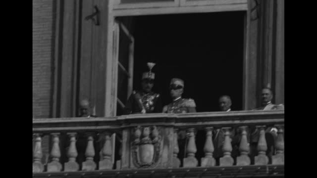 spainõs king alfonso italian king victor emanuel on royal palace balcony / princess anne of orleans and prince amedeo on balcony he waves hat / ws... - king royal person stock videos & royalty-free footage