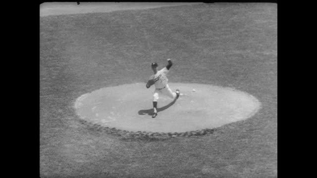 span of the large crowd at stadium/ playing the game / stadium crowd in the sun / sandy koufax pitches / brooks robinson batting sends fly ball to... - hank aaron stock videos & royalty-free footage
