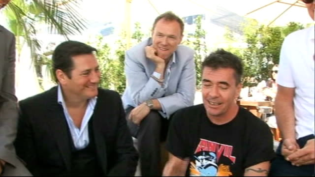 spandau ballet at cannes; spandau ballet interview sot - on their favourite songs - through the barricades one of my favourites - haven't got time... - ポピュラーミュージックツアー点の映像素材/bロール
