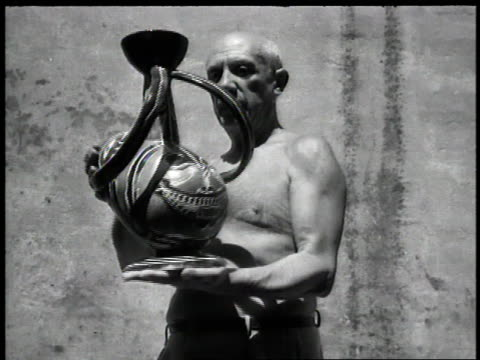 spanish artist pablo picasso holds his painted piece of pottery cruche - artist stock videos & royalty-free footage