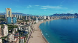 Spanish city Benidorm buildings and sandy beach Poniente
