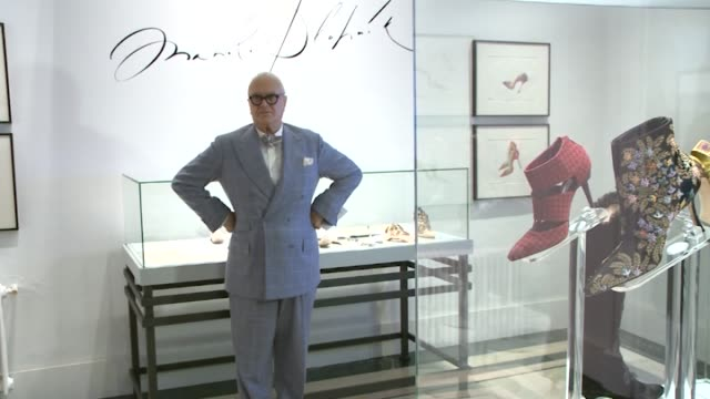 spanish designer manolo blahnik poses during the exhibition 'the art of shoes' presented by the artist himself at the museum of decorative arts in... - decorative art stock videos and b-roll footage