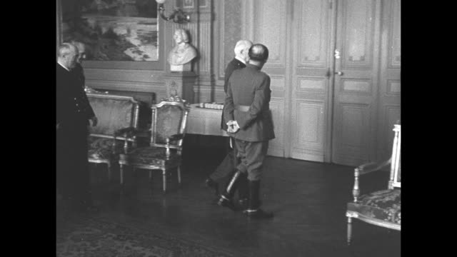 ms spanish dictator francisco franco and vichy french leader henriphilippe petain enter room followed by retinue / ms semi rear view of franco and... - dictator stock videos & royalty-free footage