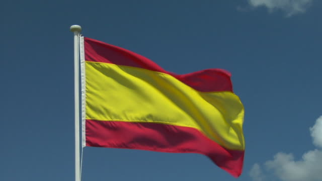 cu, spanish flag flapping against sky - spanish flag stock videos and b-roll footage