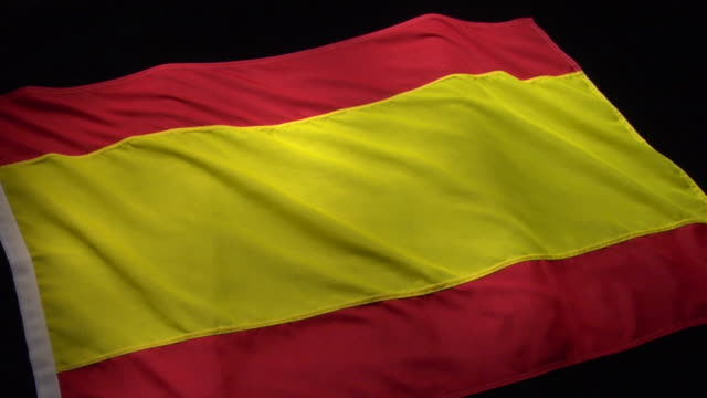 cu, pan, spanish flag on black background - スペイン国旗点の映像素材/bロール