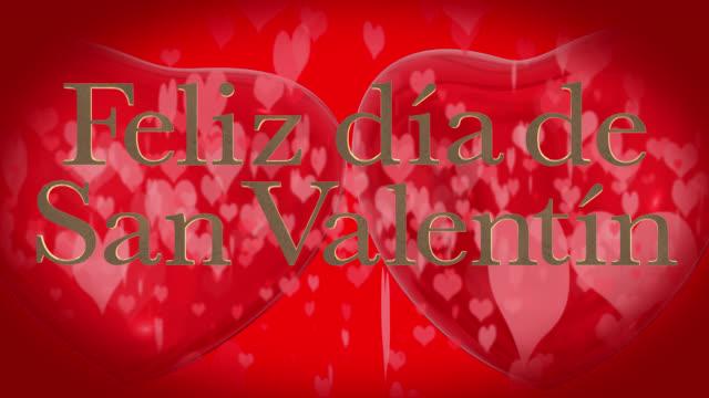 vídeos de stock, filmes e b-roll de frase do dia espanhol feliz dia dos namorados, feliz día de san valentín com dois batendo 3d corações vermelhos e movendo-se de partículas em forma de coração são de fundo vermelho - símbolo conceitual