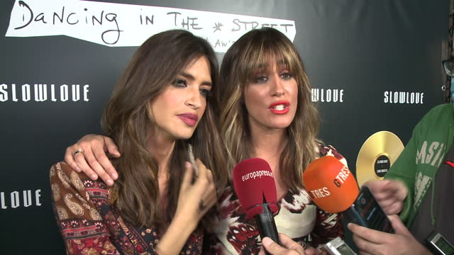 spanish journalists sara carbonero and isabel jimenez pose at the presentation of their new collection 'slow love: dancing in the street' at bardot... - サラ カルボネロ点の映像素材/bロール