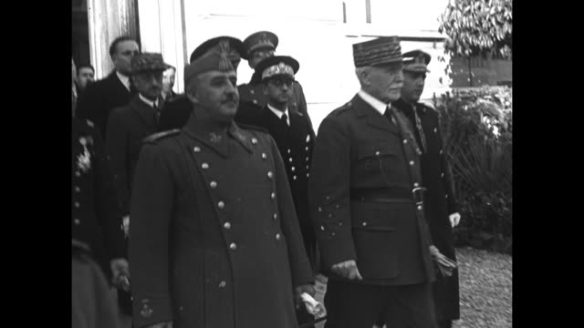 mls spanish leader general francisco franco and vichy french leader henriphilippe petain exit building with other officials following behind / vs... - dictator stock videos & royalty-free footage