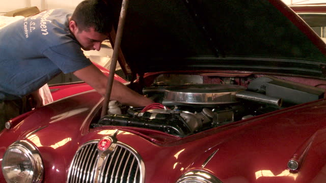 spanish mechanic works on car engine - one young man only stock videos & royalty-free footage
