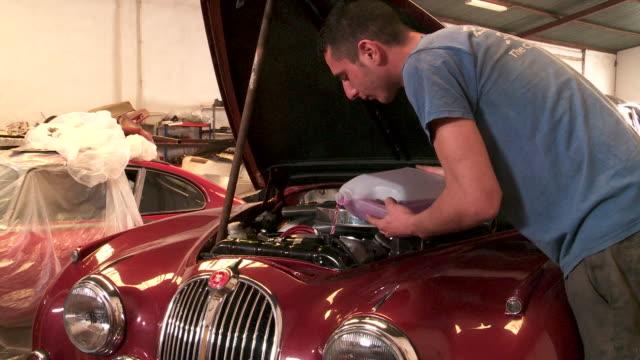 spanish mechanic works on car engine - car mechanic stock videos & royalty-free footage