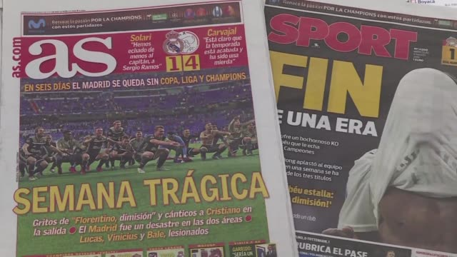 spanish newspapers report on real madrid's elimination in the champions league round of 16 against dutch side ajax - elimination round stock videos and b-roll footage