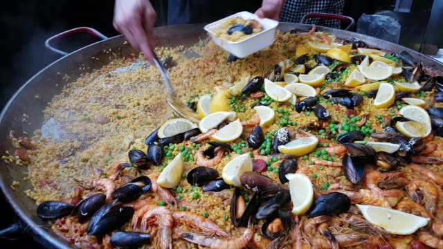 spanish paella being prepared on food market - market stall stock videos & royalty-free footage