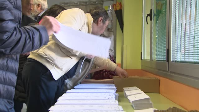 Spanish people cast their ballots at a polling station during Spain's general election at a polling station Spaniards went to the polls today to vote...