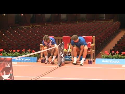 Spanish players Rafael Nadal and David Ferrer pose inside the Gran Teatre del Liceu ahead of the Barcelona Open tennis tournament Conde de Godo